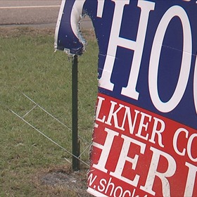 Burned Campaign Sign_-3569717947970269623