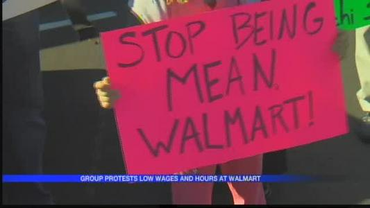 Group protest at Chenal Walmart against low wages_8858269674365603049