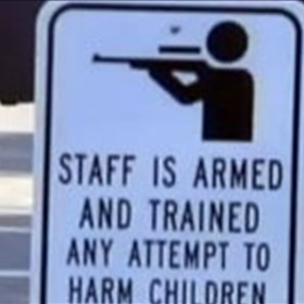 School Staff is Armed sign_-4617761368109528177