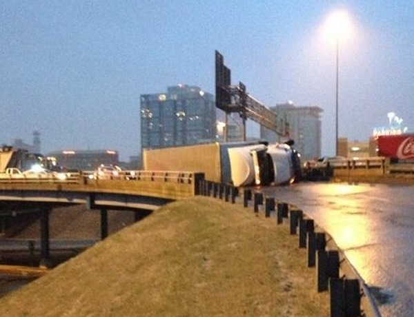 Flipped truck on I-30 near the Cantrell Rd. exit Tuesday morning._-8201101378696887411
