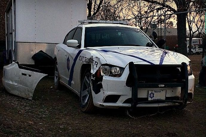 Damaged Arkansas State Police car after Feb. 26 chase ended in Yell County._-2088217816713311020