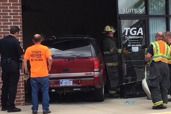 SUV crashes through The Gann Agency in Bryant_-6718726879019382787
