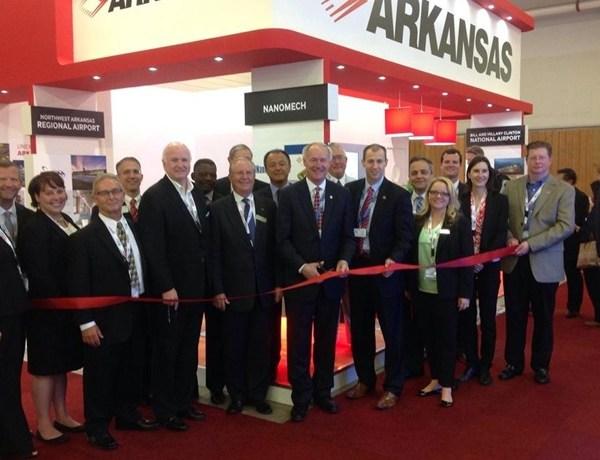 Gov. Asa Hutchinson and Arkansas delegation at Paris (France) Air Show ribbon cutting for Arkansas booth._-8276218951785627224