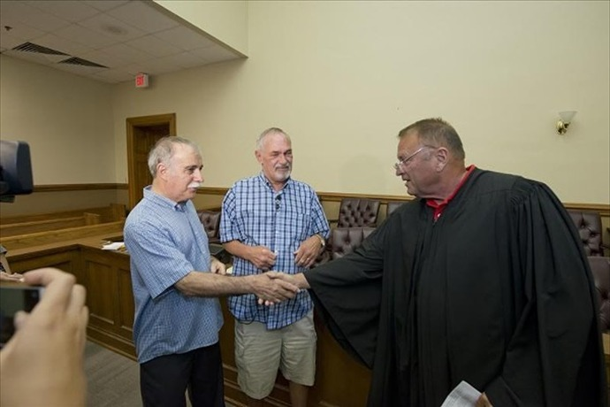 Judge Piazza congratulates newlyweds Anthony Chiaro and Earnie Matheson. (Arkansas Times, Brian Chilson)_2917062171384564338