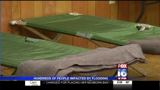Flood Families Taking Shelter_-7015287246956969700