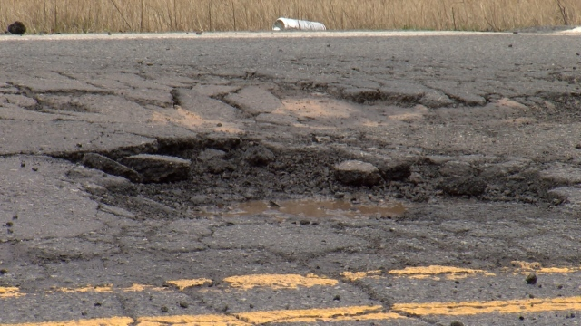 Drivers still waiting for pothole repairs on busy road in NLR