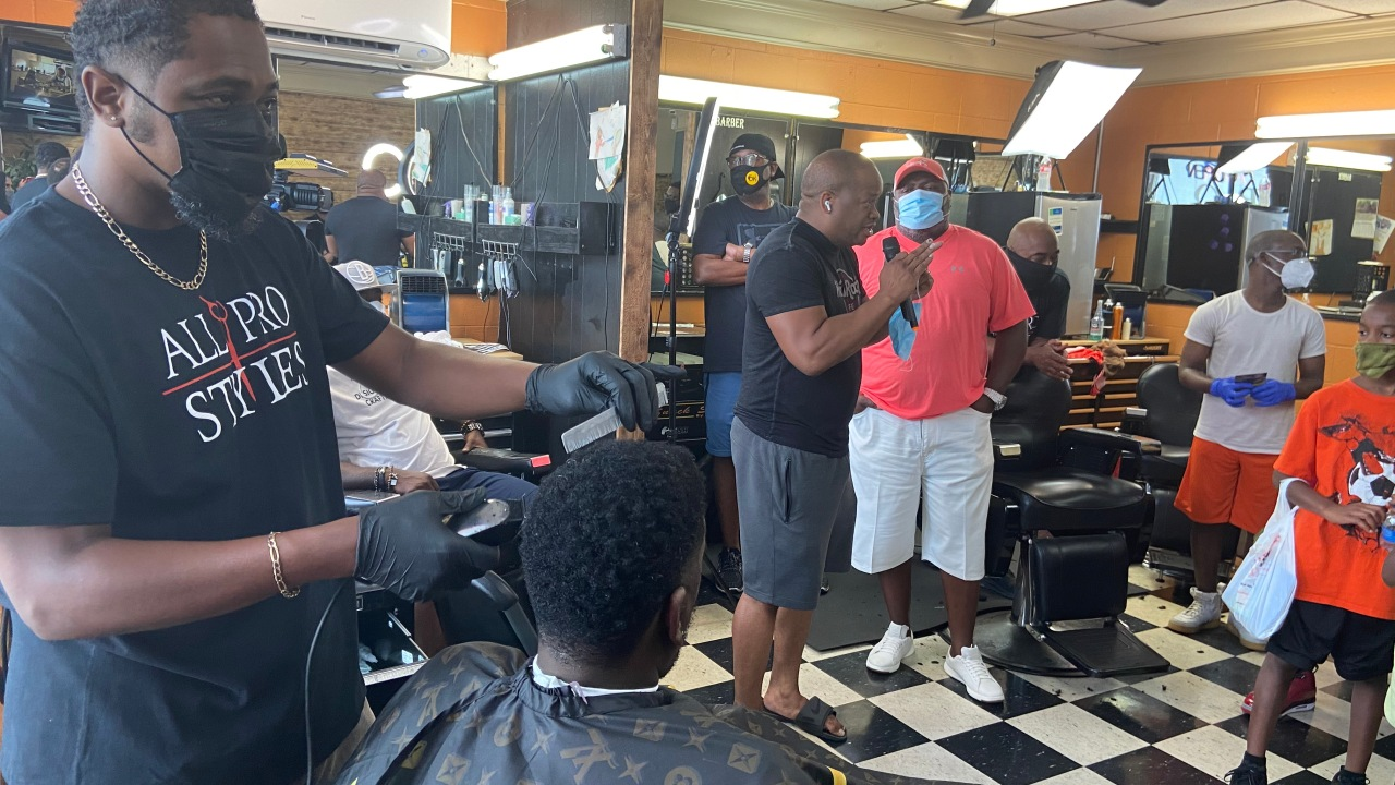 LR Barbershop partners chops cuts and conversations with LRPD